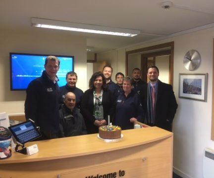 Dan McKiernan and JWD staff celebrate 1 year anniversary