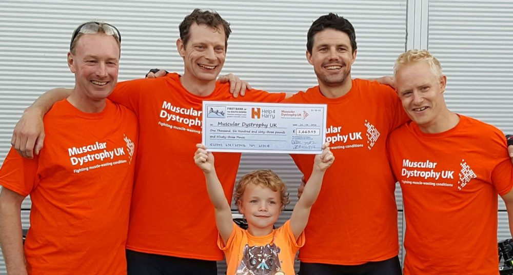 Phil, Dan, Padhraic and Simon with Harry and the Cheque for Muscular Dystrophy UK